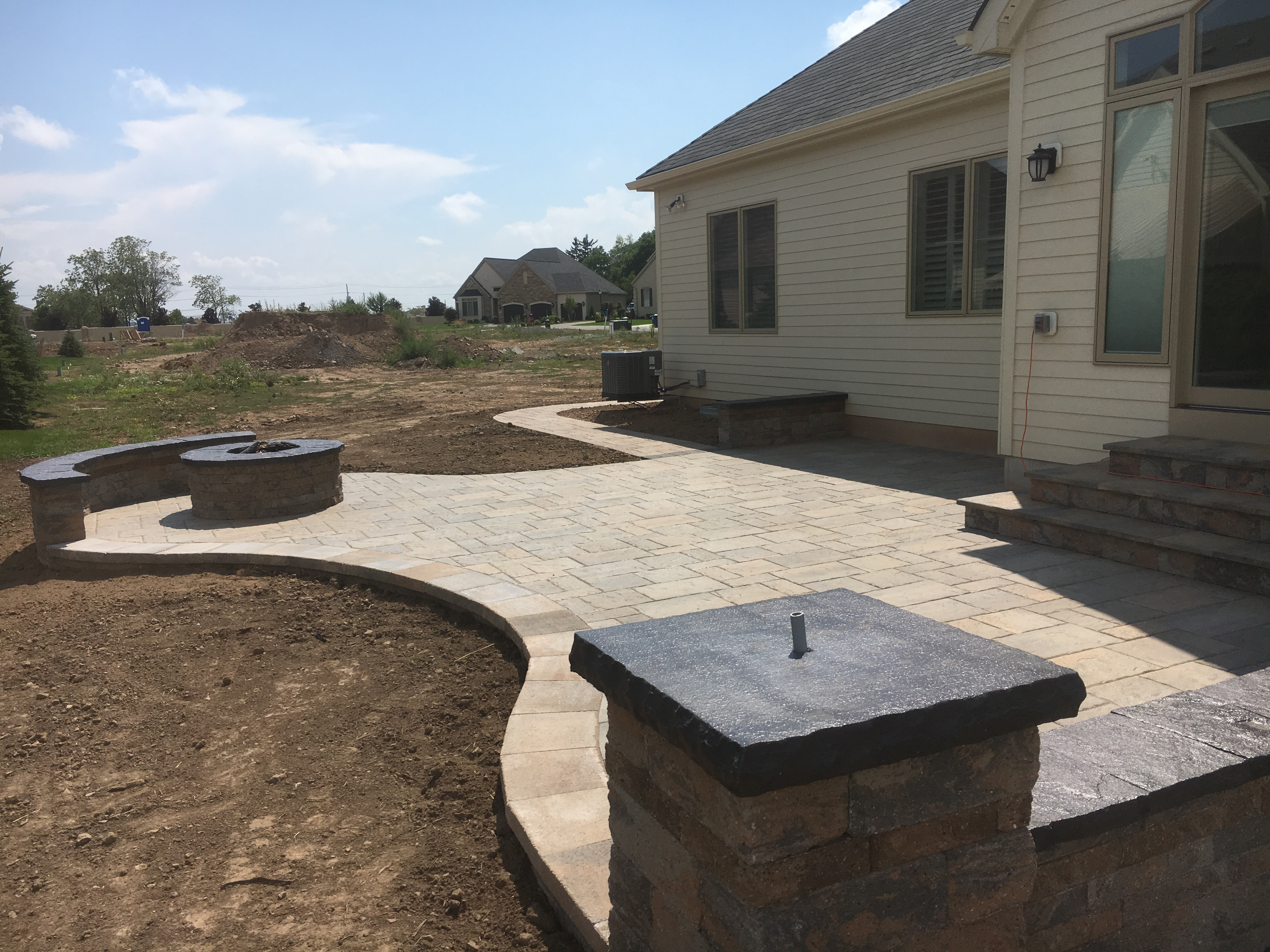 Rear Yard Patio with Seat Wall and Fire Pit